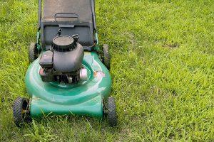A modern lawn mower cutting through the grass.