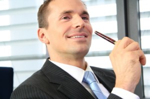 Businessman with pen, Ready to Get Growing?
